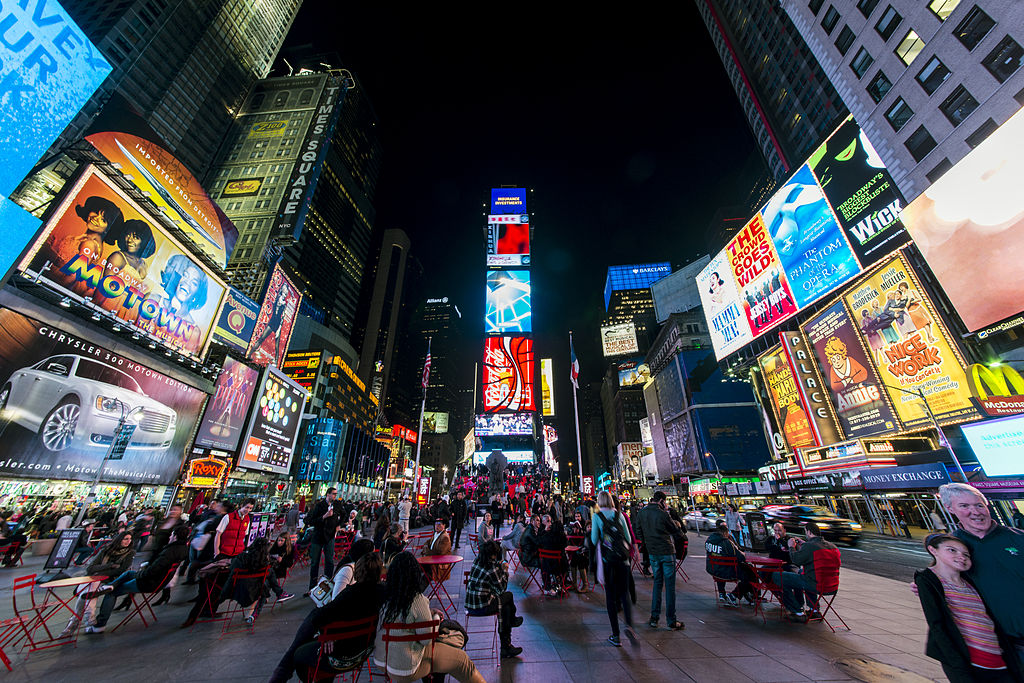 Times Square, New York City, at night. Taken by Wikimedia Commons user chensiyuan.